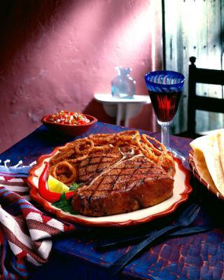 Come cucinare una bistecca Porterhouse tenera in una griglia