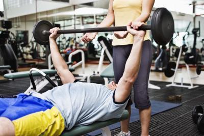 Tendine del braccio, dolore muscolare & distorsione da sollevamento pesi
