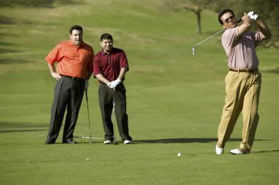 Come fare una girata di spalle corretto per un'oscillazione di Golf