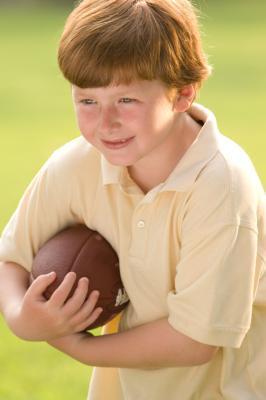 Come insegnare ai figli a catturare un pallone da calcio
