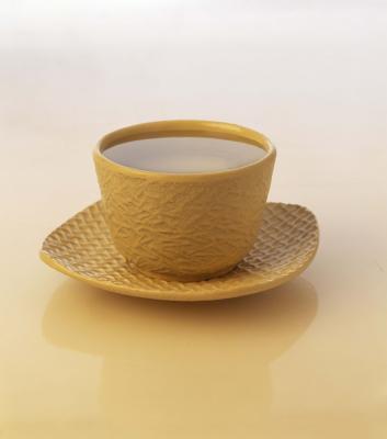 Fa caldo tè verde con limone & aiuto miele con malessere generale?
